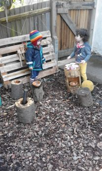 Outdoor sensorial exploration in mud kitchen